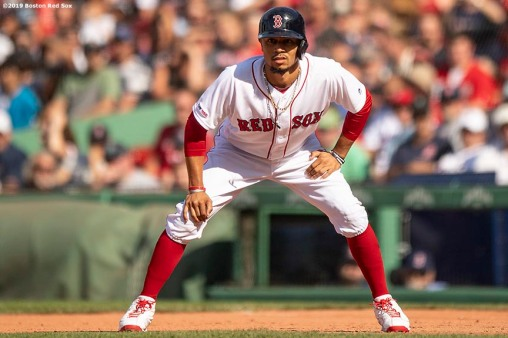 BOSTON, MA - AUGUST 11: Mookie Betts #50 of the Boston Red Sox takes a lead during the ninth inning of a game against the Los Angeles Angels of Anaheim on August 11, 2019 at Fenway Park in Boston, Massachusetts. (Photo by Billie Weiss/Boston Red Sox/Getty Images) *** Local Caption *** Mookie Betts