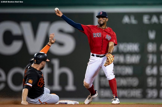 BOSTON, MA - AUGUST 16: Xander Bogaerts #2 of the Boston Red Sox turns a double play during the sixth inning of a game against the Baltimore Orioles on August 16, 2019 at Fenway Park in Boston, Massachusetts. (Photo by Billie Weiss/Boston Red Sox/Getty Images) *** Local Caption *** Xander Bogaerts