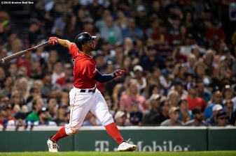 BOSTON, MA - AUGUST 16: Xander Bogaerts #2 of the Boston Red Sox hits a double during the seventh inning of a game against the Baltimore Orioles on August 16, 2019 at Fenway Park in Boston, Massachusetts. (Photo by Billie Weiss/Boston Red Sox/Getty Images) *** Local Caption *** Xander Bogaerts