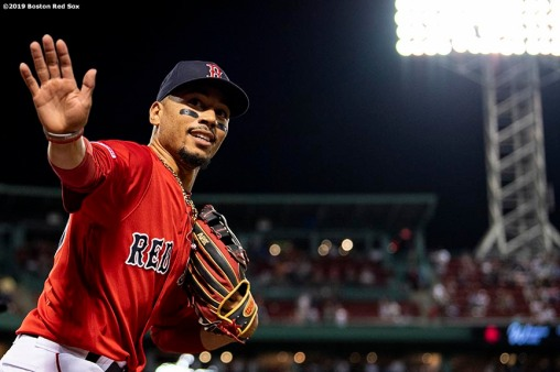BOSTON, MA - AUGUST 16: Mookie Betts #50 of the Boston Red Sox waves during the ninth inning of a game against the Baltimore Orioles on August 16, 2019 at Fenway Park in Boston, Massachusetts. (Photo by Billie Weiss/Boston Red Sox/Getty Images) *** Local Caption *** Mookie Betts
