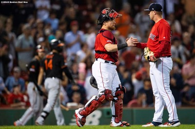 BOSTON, MA - AUGUST 16: Travis Lakins #56 of the Boston Red Sox high fives Christian Vazquez #7 after a victory against the Baltimore Orioles on August 16, 2019 at Fenway Park in Boston, Massachusetts. (Photo by Billie Weiss/Boston Red Sox/Getty Images) *** Local Caption *** Travis Lakins; Christian Vazquez