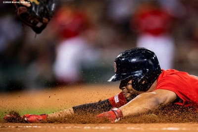 BOSTON, MA - AUGUST 17: Xander Bogaerts #2 of the Boston Red Sox slides into first base after hitting a single during the fifth inning of a game against the Baltimore Orioles on August 17, 2019 at Fenway Park in Boston, Massachusetts. (Photo by Billie Weiss/Boston Red Sox/Getty Images) *** Local Caption *** Xander Bogaerts