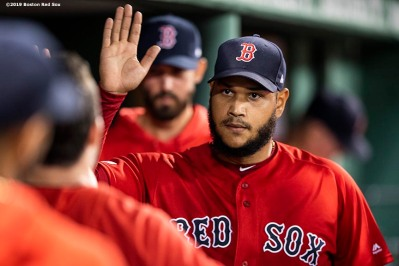 BOSTON, MA - AUGUST 17: Eduardo Rodriguez #57 of the Boston Red Sox high fives teammates as he exits the game during the eighth inning of a game against the Baltimore Orioles on August 17, 2019 at Fenway Park in Boston, Massachusetts. (Photo by Billie Weiss/Boston Red Sox/Getty Images) *** Local Caption *** Eduardo Rodriguez