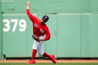 BOSTON, MA - AUGUST 18: Mookie Betts #50 of the Boston Red Sox throws the ball during the second inning of a game against the Baltimore Orioles on August 18, 2019 at Fenway Park in Boston, Massachusetts. (Photo by Billie Weiss/Boston Red Sox/Getty Images) *** Local Caption *** Mookie Betts