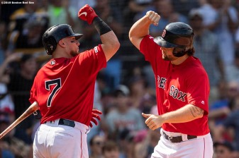 BOSTON, MA - AUGUST 18: Sam Travis #59 of the Boston Red Sox high fives Christian Vazquez #7 after hitting a solo home run during the fourth inning of a game against the Baltimore Orioles on August 18, 2019 at Fenway Park in Boston, Massachusetts. (Photo by Billie Weiss/Boston Red Sox/Getty Images) *** Local Caption *** Sam Travis; Christian Vazquez