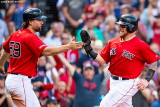 BOSTON, MA - AUGUST 18: Christian Vazquez #7 and Sam Travis #59 of the Boston Red Sox high five each other after scoring during the sixth inning of a game against the Baltimore Orioles on August 18, 2019 at Fenway Park in Boston, Massachusetts. (Photo by Billie Weiss/Boston Red Sox/Getty Images) *** Local Caption *** Christian Vazquez; Sam Travis