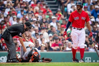 BOSTON, MA - AUGUST 18: Xander Bogaerts #2 of the Boston Red Sox reacts as Chance Sisco #15 of the Baltimore Orioles is injured during the sixth inning of a game on August 18, 2019 at Fenway Park in Boston, Massachusetts. (Photo by Billie Weiss/Boston Red Sox/Getty Images) *** Local Caption *** Xander Bogaerts; Chance Sisco