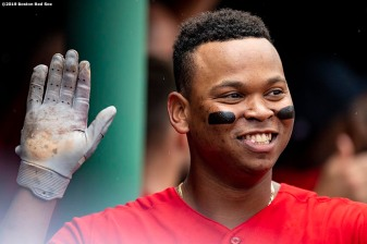 BOSTON, MA - AUGUST 18: Rafael Devers #11 of the Boston Red Sox reacts as he high fives teammates after hitting a two run home run to record his 100th and 101st RBI of the season during the seventh inning of a game against the Baltimore Orioles on August 18, 2019 at Fenway Park in Boston, Massachusetts. (Photo by Billie Weiss/Boston Red Sox/Getty Images) *** Local Caption *** Rafael Devers