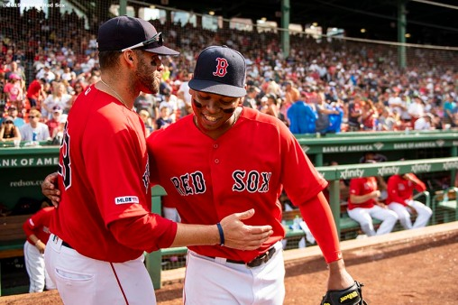 BOSTON, MA - AUGUST 18: Rafael Devers #11 of the Boston Red Sox hugs J.D. Martinez #28 after hitting a two run home run to record his 100th and 101st RBI of the season during the seventh inning of a game against the Baltimore Orioles on August 18, 2019 at Fenway Park in Boston, Massachusetts. (Photo by Billie Weiss/Boston Red Sox/Getty Images) *** Local Caption *** Rafael Devers; J.D. Martinez
