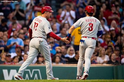 BOSTON, MA - AUGUST 20: Bryce Harper #3 of the Philadelphia Phillies high fives Rhys Hoskins #17 after scoring during the first inning of a game against the Boston Red Sox on August 20, 2019 at Fenway Park in Boston, Massachusetts. (Photo by Billie Weiss/Boston Red Sox/Getty Images) *** Local Caption *** Bryce Harper; Rhys Hoskins