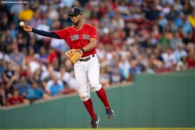 BOSTON, MA - AUGUST 20: Xander Bogaerts #2 of the Boston Red Sox throws during the first inning of a game against the Philadelphia Phillies on August 20, 2019 at Fenway Park in Boston, Massachusetts. (Photo by Billie Weiss/Boston Red Sox/Getty Images) *** Local Caption *** Xander Bogaerts