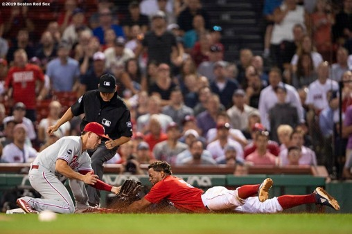 BOSTON, MA - AUGUST 20: Xander Bogaerts #2 of the Boston Red Sox is tagged out by Scott Kingery #4 of the Philadelphia Phillies as he attempts to advance to third base on a fielder's choice ground ball during the ninth inning of a game on August 20, 2019 at Fenway Park in Boston, Massachusetts. (Photo by Billie Weiss/Boston Red Sox/Getty Images) *** Local Caption *** Xander Bogaerts; Scott Kingery