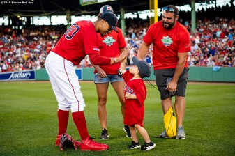 BOSTON, MA - AUGUST 20: A Jimmy Fund patient high fives Mookie Betts #50 of the Boston Red Sox during the Boston Red Sox 18th Annual WEEI-NESN Jimmy Fund Radio-Telethon pre-game ceremony before a game against the Philadelphia Phillies on August 20, 2019 at Fenway Park in Boston, Massachusetts. (Photo by Billie Weiss/Boston Red Sox/Getty Images) *** Local Caption *** Mookie Betts
