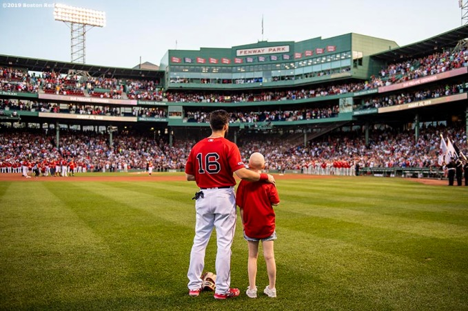 BOSTON, MA - AUGUST 20: Andrew Benintendi #16 of the Boston Red Sox looks on with a Jimmy Fund patient during the Boston Red Sox 18th Annual WEEI-NESN Jimmy Fund Radio-Telethon pre-game ceremony before a game against the Philadelphia Phillies on August 20, 2019 at Fenway Park in Boston, Massachusetts. (Photo by Billie Weiss/Boston Red Sox/Getty Images) *** Local Caption *** Andrew Benintendi