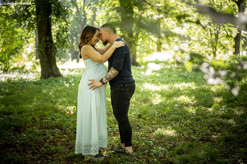 """Gaby and Christian Vazquez pose for maternity photos at Arnold Arboretum in Jamaica Plain, Massachusetts."""
