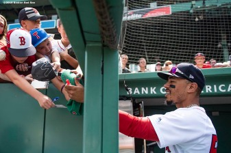 BOSTON, MA - AUGUST 22: Mookie Betts #50 of the Boston Red Sox signs autographs before a game against the Kansas City Royals on August 22, 2019 at Fenway Park in Boston, Massachusetts. The game is the completion of the game that was suspended due to weather on August 7 in the top of the 10th inning with a tied score of 4-4. (Photo by Billie Weiss/Boston Red Sox/Getty Images) *** Local Caption ***