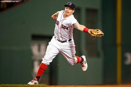 BOSTON, MA - SEPTEMBER 8: Brock Holt #12 of the Boston Red Sox reaches for a thrown ball during the fourth inning of a game against the New York Yankees on September 8, 2019 at Fenway Park in Boston, Massachusetts. (Photo by Billie Weiss/Boston Red Sox/Getty Images) *** Local Caption *** Brock Holt