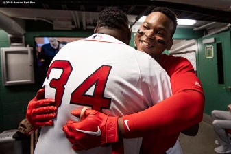 BOSTON, MA - SEPTEMBER 9: Former designated hitter David Ortiz #34 of the Boston Red Sox greets Rafael Devers #11 of the Boston Red Sox before throwing out a ceremonial first pitch as he returns to Fenway Park before a game against the New York Yankees on September 9, 2019 at Fenway Park in Boston, Massachusetts. (Photo by Billie Weiss/Boston Red Sox/Getty Images) *** Local Caption *** David Ortiz; Rafael Devers