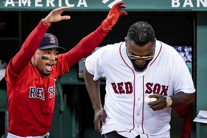 BOSTON, MA - SEPTEMBER 9: Mookie Betts #50 of the Boston Red Sox reacts as former designated hitter David Ortiz #34 of the Boston Red Sox is introduced before throwing out a ceremonial first pitch as he returns to Fenway Park before a game against the New York Yankees on September 9, 2019 at Fenway Park in Boston, Massachusetts. (Photo by Billie Weiss/Boston Red Sox/Getty Images) *** Local Caption *** David Ortiz; Mookie Betts