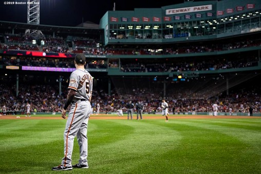 BOSTON, MA - SEPTEMBER 17: Mike Yastrzemski #5 of the San Francisco Giants looks on in left field during the first inning of a game against the Boston Red Sox on September 17, 2019 at Fenway Park in Boston, Massachusetts. (Photo by Billie Weiss/Boston Red Sox/Getty Images) *** Local Caption *** Mike Yastrzemski