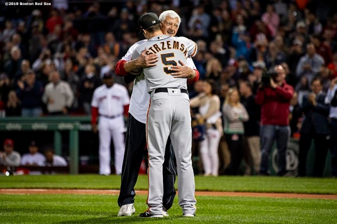 BOSTON, MA - SEPTEMBER 18: Former left fielder Carl Yastrzemski of the Boston Red Sox hugs grandson Mike Yastrzemski #5 of the San Francisco Giants before throwing out a ceremonial first pitch before a game on September 18, 2019 at Fenway Park in Boston, Massachusetts. (Photo by Billie Weiss/Boston Red Sox/Getty Images) *** Local Caption *** Carl Yastrzemski; Mike Yastrzemski