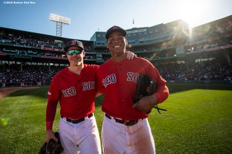 BOSTON, MA - SEPTEMBER 19: Brock Holt #12 and Rafael Devers #11 of the Boston Red Sox pose as they celebrate a victory against the San Francisco Giants on September 19, 2019 at Fenway Park in Boston, Massachusetts. (Photo by Billie Weiss/Boston Red Sox/Getty Images) *** Local Caption *** Rafael Devers; Brock Holt