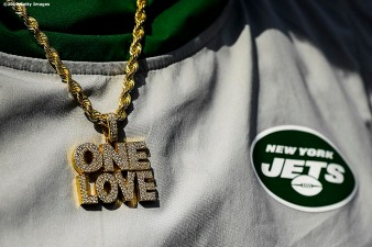 FOXBOROUGH, MA - SEPTEMBER 22: A necklace on a member of the New York Jets is displayed during a game against the New England Patriots at Gillette Stadium on September 22, 2019 in Foxborough, Massachusetts. (Photo by Billie Weiss/Getty Images) *** Local Caption ***