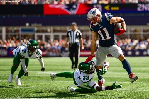 FOXBOROUGH, MA - SEPTEMBER 22: Julian Edelman #11 of the New England Patriots evades a tackle by Jamal Adams #33 of the New York Jets during the second quarter of a game at Gillette Stadium on September 22, 2019 in Foxborough, Massachusetts. (Photo by Billie Weiss/Getty Images) *** Local Caption *** Julian Edelman; Jamal Adams