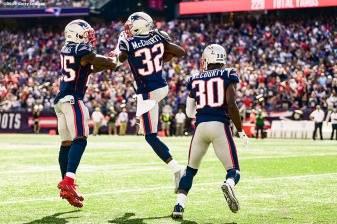 FOXBOROUGH, MA - SEPTEMBER 22: Devin McCourty #32 of the New England Patriots reacts with Terrence Brooks #25 and Jason McCourty #30 after intercepting a pass during the third quarter of a game against the New York Jets at Gillette Stadium on September 22, 2019 in Foxborough, Massachusetts. (Photo by Billie Weiss/Getty Images) *** Local Caption *** Devin McCourty; Jason McCourty; Terrence Brooks