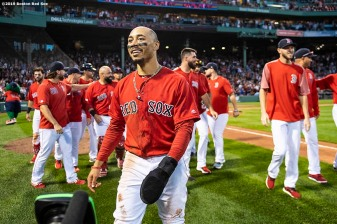 BOSTON, MA - SEPTEMBER 29: Mookie Betts #50 of the Boston Red Sox reacts after scoring the game winning run on a walk-off single hit by Rafael Devers #11 during the ninth inning of a game against the Baltimore Orioles on September 29, 2019 at Fenway Park in Boston, Massachusetts. (Photo by Billie Weiss/Boston Red Sox/Getty Images) *** Local Caption *** Mookie Betts