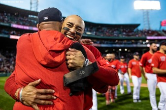 BOSTON, MA - SEPTEMBER 29: Mookie Betts #50 of the Boston Red Sox hugs manager Alex Cora after scoring the game winning run on a walk-off single hit by Rafael Devers #11 during the ninth inning of a game against the Baltimore Orioles on September 29, 2019 at Fenway Park in Boston, Massachusetts. (Photo by Billie Weiss/Boston Red Sox/Getty Images) *** Local Caption *** Mookie Betts; Alex Cora
