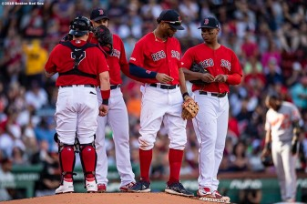 BOSTON, MA - SEPTEMBER 29: Christian Vazquez #7, Eduardo Rodriguez #57, Xander Bogaerts #2, and Rafael Devers #11 of the Boston Red Sox talk during a mound visit during the third inning of a game against the Baltimore Orioles on September 29, 2019 at Fenway Park in Boston, Massachusetts. (Photo by Billie Weiss/Boston Red Sox/Getty Images) *** Local Caption *** Christian Vazquez; Eduardo Rodriguez; Xander Bogaerts; Rafael Devers