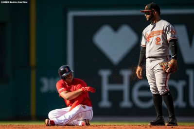 BOSTON, MA - SEPTEMBER 29: Rafael Devers #11 of the Boston Red Sox tosses dirt at Jonathan Villar #2 of the Baltimore Orioles during the fourth inning of a game on September 29, 2019 at Fenway Park in Boston, Massachusetts. (Photo by Billie Weiss/Boston Red Sox/Getty Images) *** Local Caption *** Rafael Devers; Jonathan Villar
