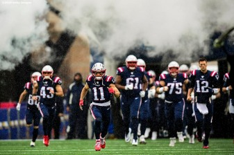 FOXBOROUGH, MASSACHUSETTS - OCTOBER 27: Wide receiver Julian Edelman #11 of the New England Patriots and teammates take the field for their game against the Cleveland Browns at Gillette Stadium on October 27, 2019 in Foxborough, Massachusetts. (Photo by Billie Weiss/Getty Images)
