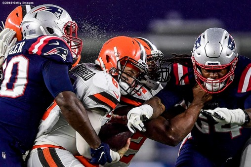 FOXBOROUGH, MASSACHUSETTS - OCTOBER 27: Defensive tackle Adam Butler #70 of the New England Patriots sacks quarterback Baker Mayfield #6 of the Cleveland Browns of the game at Gillette Stadium on October 27, 2019 in Foxborough, Massachusetts. (Photo by Billie Weiss/Getty Images)
