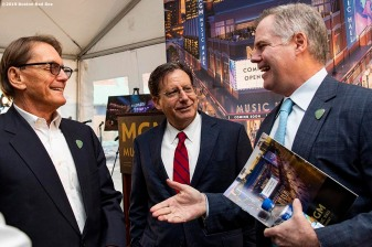 BOSTON, MA - NOVEMBER 22: President of Live Nation New England Don Law, Boston Red Sox Chairman Tom Werner, and Chairman and CEO of MGM Resorts Jim Murren talk during a groundbreaking ceremony for the MGM Music Hall at Fenway November 22, 2019 at Fenway Park in Boston, Massachusetts. (Photo by Billie Weiss/Boston Red Sox/Getty Images) *** Local Caption *** Don Law; Tom Werner; Jim Murren