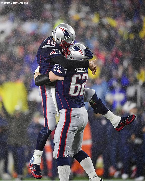 FOXBOROUGH, MA - NOVEMBER 24: Tom Brady #12 of the New England Patriots celebrates with Joe Thuney #62 after throwing a touchdown pass during the first quarter against the Dallas Cowboys in the game at Gillette Stadium on November 24, 2019 in Foxborough, Massachusetts.(Photo by Billie Weiss/Getty Images) *** Local Caption *** Tom Brady; Joe Thuney