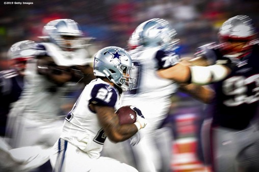 FOXBOROUGH, MA - NOVEMBER 24: Ezekiel Elliot #21 of the Dallas Cowboys carries the ball during a game against the New England Patriots at Gillette Stadium on November 24, 2019 in Foxborough, Massachusetts. (Photo by Billie Weiss/Getty Images) *** Local Caption *** Ezekiel Elliot