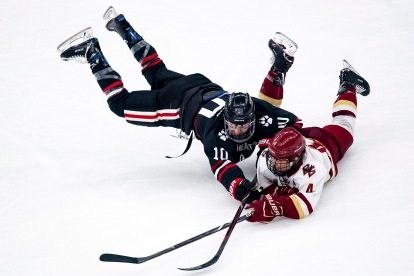 February 11, 2019, Boston, MA: Michael Kim #4 of Boston College handles the puck as he is defended by Brandon Hawkins #10 of Northeastern University in the first period during the 2019 Boston Beanpot Championship at TD Garden in Boston, Massachusetts Monday, February 11, 2019. (Photo by Billie Weiss/Boston College)