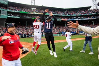 BOSTON, MA - APRIL 9: Mookie Betts #50 of the Boston Red Sox reacts with Julian Edelman #11 of the New England Patriots during a 2018 World Series championship ring ceremony before the Opening Day game against the Toronto Blue Jays on April 9, 2019 at Fenway Park in Boston, Massachusetts. (Photo by Billie Weiss/Boston Red Sox/Getty Images) *** Local Caption *** Mookie Betts