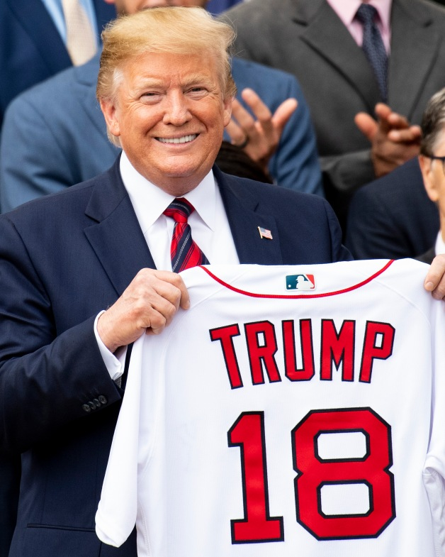 WASHINGTON, DC - MAY 9: U.S. President Donald Trump is presented with a Boston Red Sox jersey during a visit to the White House in recognition of the 2018 World Series championship on May 9, 2019 in Washington, DC. (Photo by Billie Weiss/Boston Red Sox/Getty Images) *** Local Caption *** Donald Trump