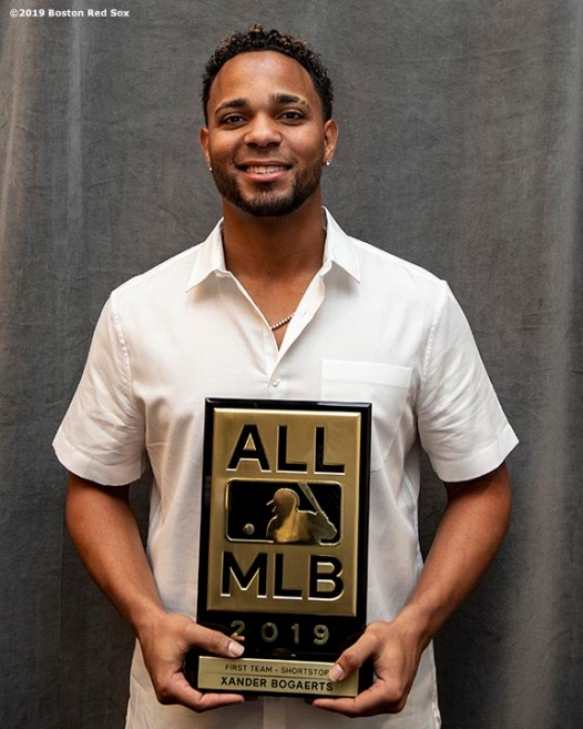 BOSTON, MA - DECEMBER 10: Xander Bogaerts #2 of the Boston Red Sox poses with the plaque after being introduced as a member of the 2019 All-MLB team during the 2019 Major League Baseball Winter Meetings on December 10, 2019 in San Diego, California. (Photo by Billie Weiss/Boston Red Sox/Getty Images) *** Local Caption *** Xander Bogaerts