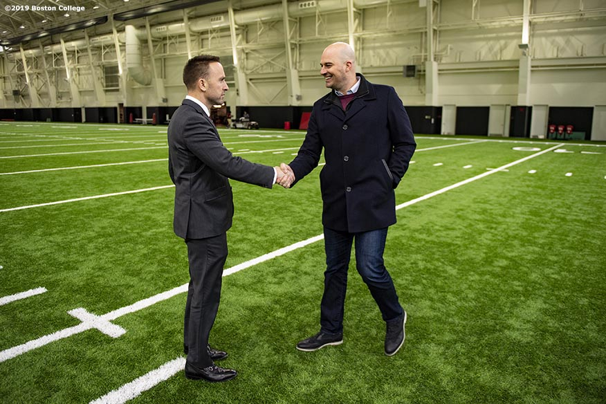 December 16, 2019, Chestnut Hill, MA: Newly appointed Boston College Football Head Coach Jeff Hafley greets Matt Hasselbeck during his first day at Boston College in Chestnut Hill, Massachusetts Monday, December 16, 2019. (Photo by Billie Weiss/Boston College)