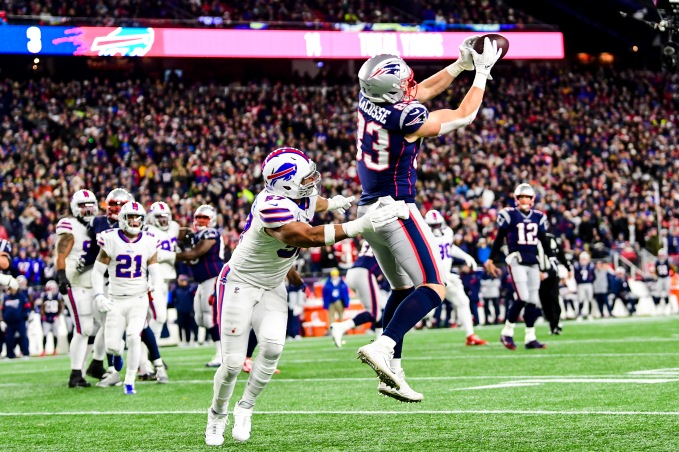 FOXBOROUGH, MASSACHUSETTS - DECEMBER 21: Matt LaCosse #83 of the New England Patriots scores a touchdown during the first quarter against Lorenzo Alexander #57 of the Buffalo Bills in the game at Gillette Stadium on December 21, 2019 in Foxborough, Massachusetts. (Photo by Billie Weiss/Getty Images)