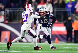 FOXBOROUGH, MASSACHUSETTS - DECEMBER 21: Tom Brady #12 of the New England Patriots looks to block Tre'Davious White #27 of the Buffalo Bills during the first half in the game at Gillette Stadium on December 21, 2019 in Foxborough, Massachusetts. (Photo by Billie Weiss/Getty Images)