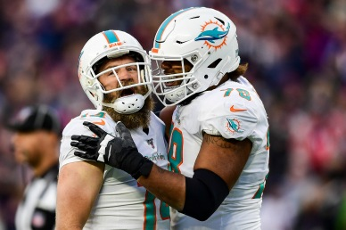 FOXBOROUGH, MA - DECEMBER 29: Ryan Fitzpatrick #14 of the Miami Dolphins reacts with Adam Pankey #78 after throwing the game winning touchdown pass during the fourth quarter of a game against the New England Patriots at Gillette Stadium on December 29, 2019 in Foxborough, Massachusetts. (Photo by Billie Weiss/Getty Images) *** Local Caption *** Ryan Fitzpatrick; Adam Pankey