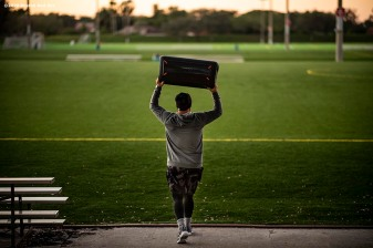 WESTON, FL - DECEMBER 3: Christian Vazquez #7 of the Boston Red Sox carries a speaker system before an early morning off-season workout on December 3, 2019 at in Weston, Florida. (Photo by Billie Weiss/Boston Red Sox/Getty Images) *** Local Caption *** Christian Vazquez
