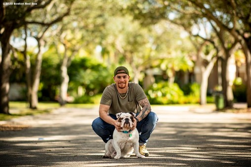 WESTON, FL - DECEMBER 4: Christian Vazquez #7 of the Boston Red Sox poses for a portrait with his dog Champs at his home on December 4, 2019 in Weston, Florida. (Photo by Billie Weiss/Boston Red Sox/Getty Images) *** Local Caption *** Christian Vazquez