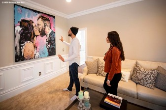 NEWTOWN, CT - DECEMBER 20: Matt Barnes #32 of the Boston Red Sox looks at a portrait from their wedding day with his wife Chelsea Barnes on December 20, 2019 at his home in Newtown, Connecticut. (Photo by Billie Weiss/Boston Red Sox/Getty Images) *** Local Caption *** Matt Barnes