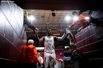 February 4, 2020, Chestnut Hill, MA: Members of Boston College high five fans in the tunnel before a game against Duke University at Conte Forum at Boston College in Chestnut Hill, Massachusetts Tuesday, February 4, 2020. (Photo by Billie Weiss/Boston College)